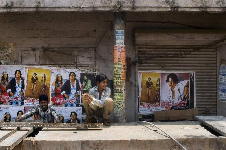 Bollywood posters adorn streets throughout India, (photo by Britta Jaschinski)