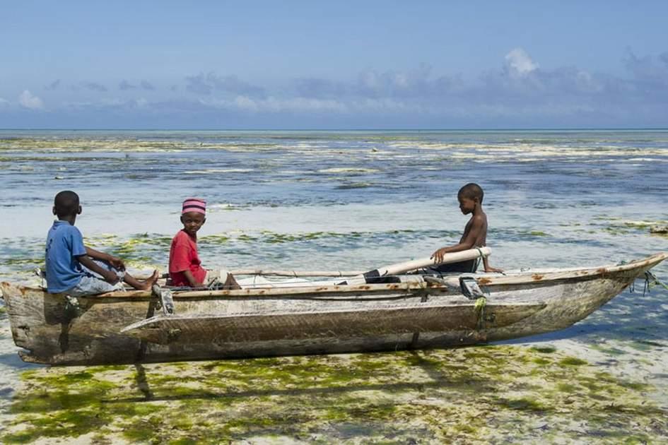 Children in a boat in Zanzibar, (photo by Ariadne Van Zandbergen)