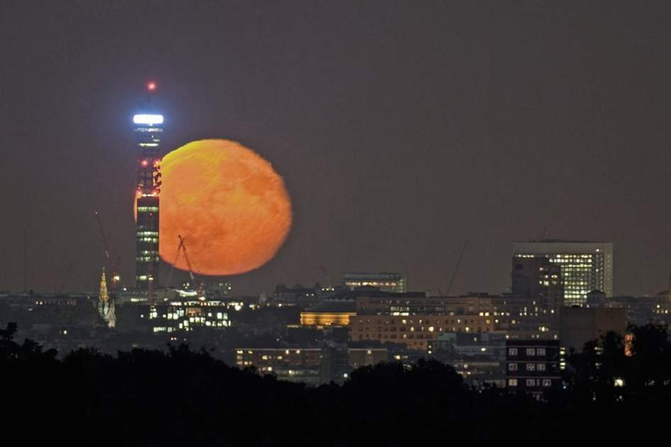 Moon behind the BT Tower in London, (photo by James Macdonald)