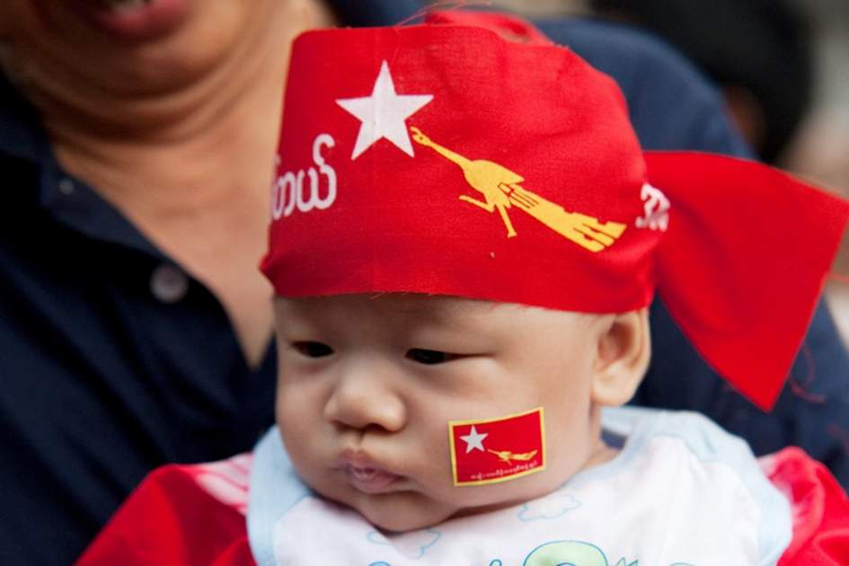 A Burmese baby wearing an NLD headband, (photo by Corrie Wingate)