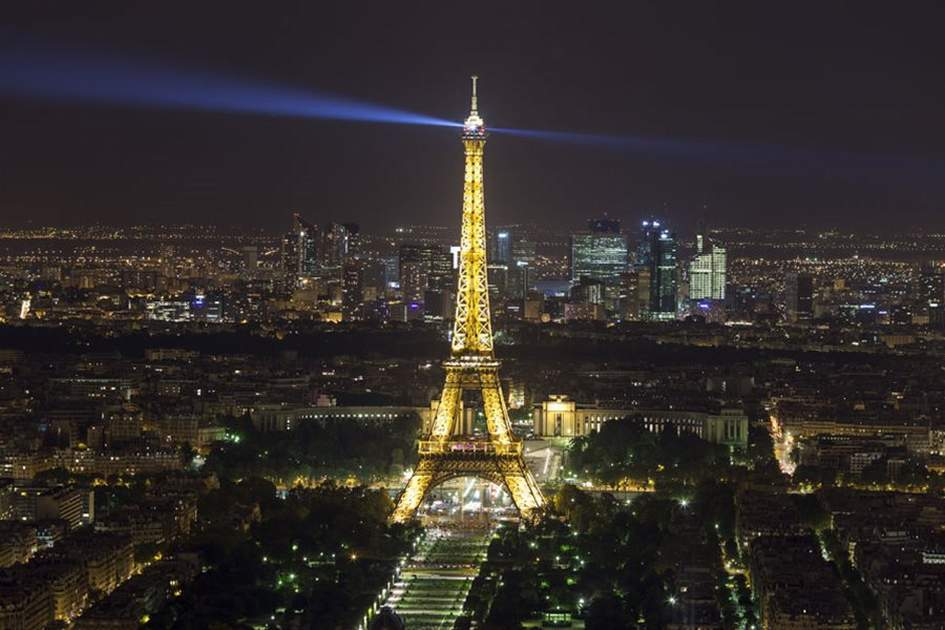 The Eiffel Tower, illuminated at night, (photo by Ming Tang-Evans)