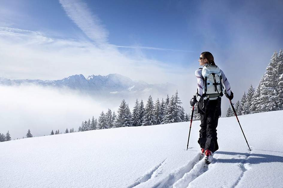Backcountry skiing in the Austrian Alps on a beautiful, sunny winter day , (photo by iStock)